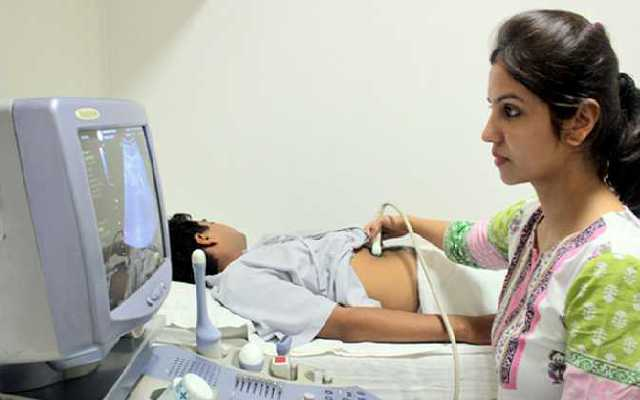 A Women checking ultrasonography for a patient.