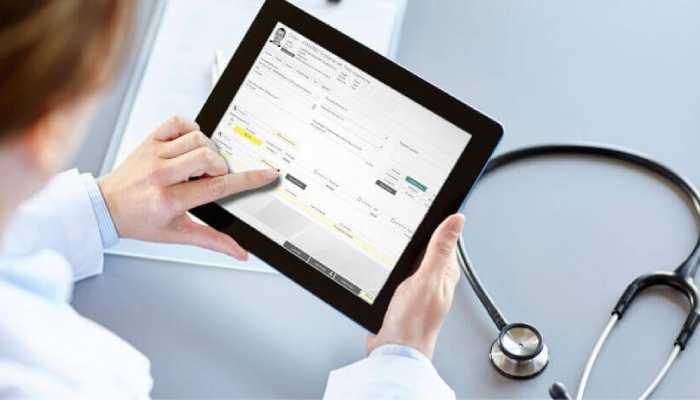 A Person operating a medical software in his tab.